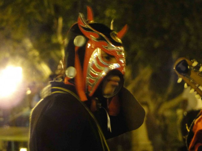 A  masked mariachi during a teachers demonstration.